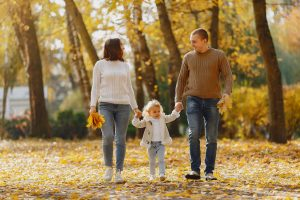 Cute and stylish family walking fun
