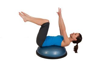 woman in blue shirt exercising her lower abs