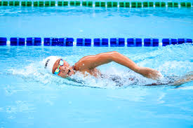 person swimming loose your belly fat