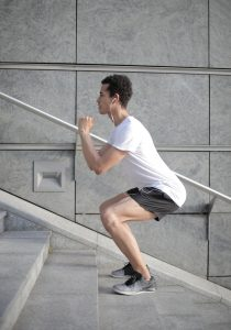 man doing step ups for his inner thigh